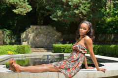 Beautiful young African American woman in floral sundress Royalty Free Stock Photo