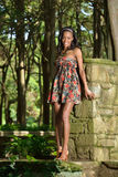 Beautiful young African American woman in floral sundress Stock Photo