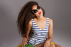 Beautiful young african american woman with long healthy hair Stock Photos