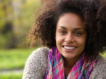 Beautiful young african american woman smiling outdoors royalty free stock images