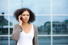 Beautiful young african american woman using cellphone Stock Photos