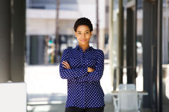 Beautiful young african business woman standing in the city. Portrait of beautiful young african business woman standing in the city Royalty Free Stock Images