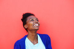 Beautiful young african female looking away and smiling Royalty Free Stock Photography