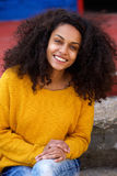 Beautiful young african lady with curly hair Royalty Free Stock Images