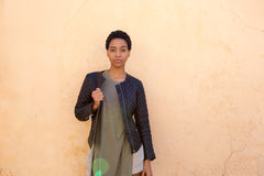 Beautiful young african woman with black jacket Royalty Free Stock Photos