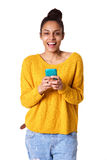 Beautiful young african woman with a cell phone Royalty Free Stock Photos