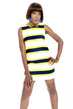 Beautiful Young African Woman Dressed in Striped Casual Dress Royalty Free Stock Images