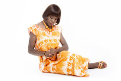 Beautiful Young African Woman Dressed in Traditional Outfit Stock Photography