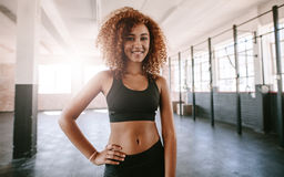 Beautiful young african woman in gym Stock Photo