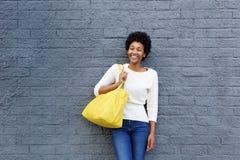 Beautiful young african woman with handbag Stock Photo