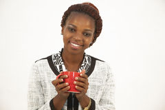 Beautiful young african woman holding a cup of coffee Stock Photography