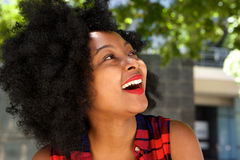 Beautiful young african woman laughing outside Stock Photos