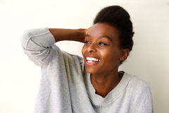 Beautiful young african woman looking away and smiling Stock Photos
