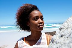 Beautiful young african woman outdoors at the beach Royalty Free Stock Photo