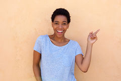 Beautiful young african woman pointing finger Stock Images