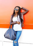 Beautiful young african woman wearing a leather jacket Royalty Free Stock Photo