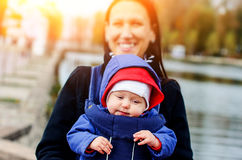 Beautiful young age she and her adorable little son in the autum Stock Image