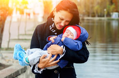 Beautiful young age she and her adorable little son in the autum Stock Images