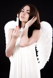 Beautiful young angel with a candle Royalty Free Stock Image