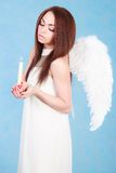Beautiful young angel with a candle Royalty Free Stock Photography