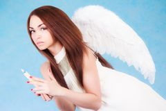 Beautiful young angel with a candle Stock Photos