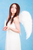 Beautiful young angel holding a candle Royalty Free Stock Image