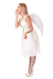 Beautiful young angel telling something Royalty Free Stock Photography