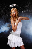 Beautiful young angel woman playing with her magic Royalty Free Stock Images