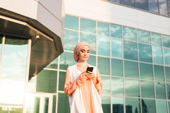 Beautiful young arabian woman with cell phone. Beautiful young arabian woman talking on cell phone Royalty Free Stock Photos