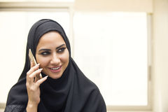 Beautiful young arabian woman talking on cell phone Royalty Free Stock Photography