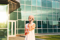 Beautiful young arabian woman talking on cell phone.  Royalty Free Stock Photo