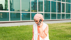 Beautiful young arabian woman talking on cell phone.  Royalty Free Stock Photography