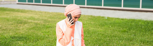Beautiful young arabian woman talking on cell phone.  Royalty Free Stock Image