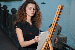 Beautiful young artist draws a picture Royalty Free Stock Image