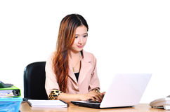 Beautiful young asian businesswomen smiling with computer notebo Royalty Free Stock Images