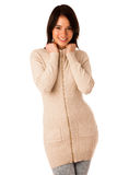 Beautiful young asian caucasian woman in sweater and jeans studio Stock Photo