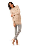 Beautiful young asian caucasian woman in sweater and jeans studio Royalty Free Stock Photo