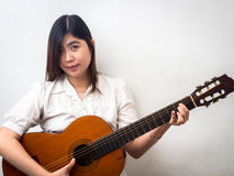 Beautiful Young Asian - Chinese Woman Playing Guitar Royalty Free Stock Images