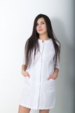 Beautiful young asian female doctor in medical gown holding a phonendoscope Stock Images