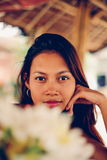 Beautiful young Asian girl chilling outside in the cortege Stock Photography