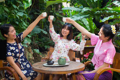 Beautiful young asian girl enjoy coffee party outdoor garden Royalty Free Stock Photography