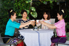 Beautiful young asian girl enjoy coffee party outdoor garden Stock Photography