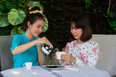 Beautiful young asian girl enjoy coffee party outdoor garden Stock Image