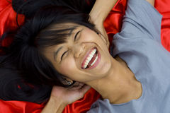 Beautiful, young asian laughing Royalty Free Stock Photo