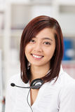 Beautiful young Asian receptionist Royalty Free Stock Photography