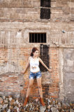 Beautiful young Asian woman. Wearing blue short jean stock photography