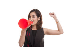 Beautiful young Asian woman announce with megaphone. stock images