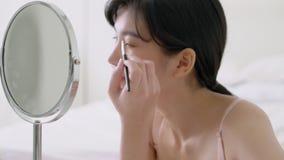 Beautiful young asian woman applying makeup eyebrows brush, beauty asia girl using cosmetic for make up