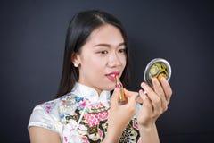 Beautiful young asian woman applying makeup Stock Photography