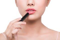 Beautiful young asian woman applying pink lipstick Stock Photography